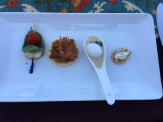 Starters (L to R): Insalate Caprese, Crabcake, Vichyssoise with Quail Egg, and Smoked Trout